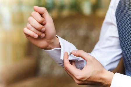 sleeve: men wear cufflinks on a shirt sleeve