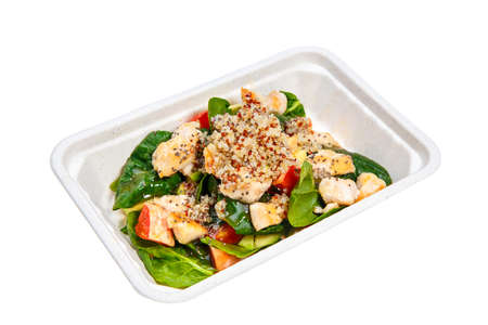 Healthy fitness salad with chicken, grapefruit, quinoa seeds and chia seeds for take away in cardboard box. Isolated on white. Stock Photo