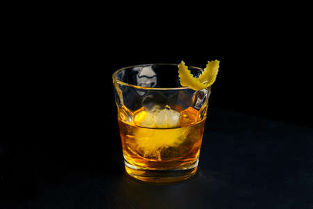 rusty nail: Cocktail RUSTY NAIL on black background