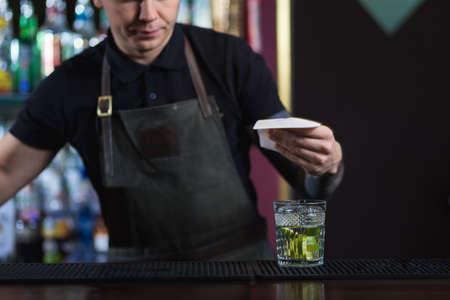 nightclub bar: The bartender making cocktail Mojito in a nightclub bar
