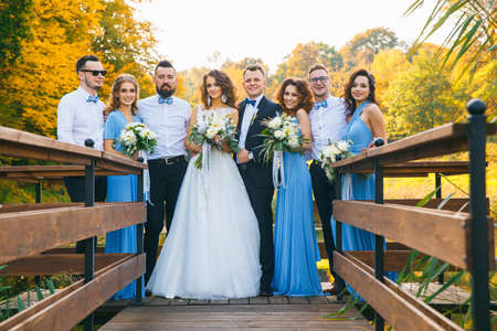 Newly married couple with groomsmen and bridesmaids posing on wedding ceremony Stock Photo
