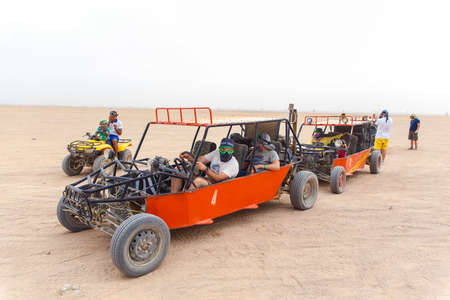 HURGHADA, EGYPT - MAY 18, 2015: Tourists ready to race in desert