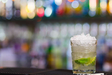 Misted over glass of Mojito cocktail on bar counter. Stock Photo