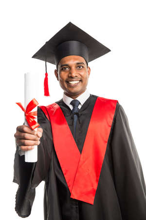 licenciatura: Male african american graduate in gown and cap isolated over white background Foto de archivo