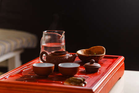 The process of brewing tea at the tea ceremony. The lid of the kettle opened to brew tea.