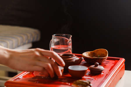 The process of brewing tea at the tea ceremony. Focus on chahe. Stock Photo