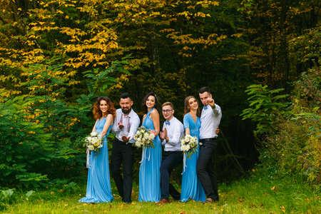 Groomsmen and bridesmaids having fun on wedding ceremony Stock Photo