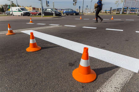 Newly applied road markings. The cones restrict the movement of vehicles.