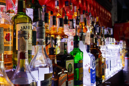 intoxicate: GRODNO, BELARUS - MAY 01, 2017: Blurred alcohol bottles on a bar at the bar London.