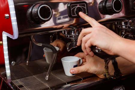 Bartender making coffee in pub, bar, restaurant