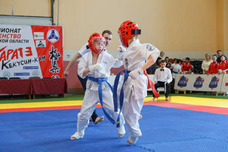 arbitros: GRODNO, BELARUS - APRIL 22, 2017: Battle of the two fighters on Championship among juniors of the Grodno region Kyokushin karate