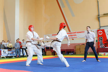 GRODNO, BELARUS - APRIL 22, 2017: Battle of the two fighters on Championship among juniors of the Grodno region Kyokushin karate