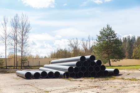 HDPE pipe for water supply stacked on the platform under the open sky