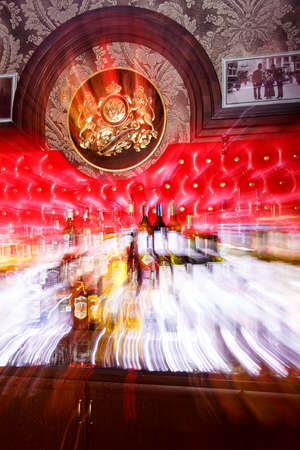 intoxicate: Grodno, Belarus - May 06, 2017: Blurred alcohol bottles on a bar in the London bar