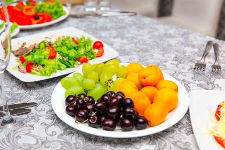 Plate with fruit dessert on holiday table Stock Photo