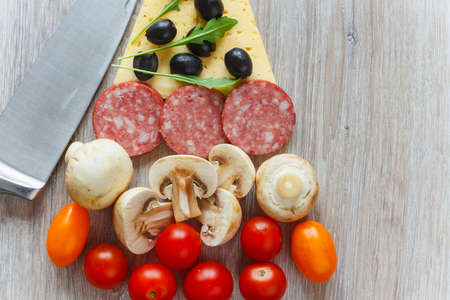 Creative composition of ingredients in the form of a slice of pizza Archivio Fotografico