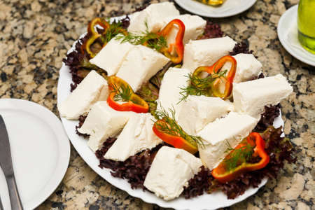 Assorted soft cheeses with spices and vegetables Stock Photo