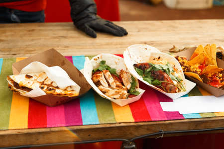 Set of mexican fast food - quesadillas, corn, nachos, gazpacho and other on street food festival