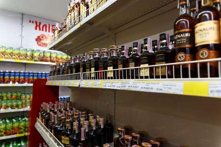 Lazurnoe, Ukraine - July 28, 2017: showcase of bottles with different kinds of cognac in a minimarket