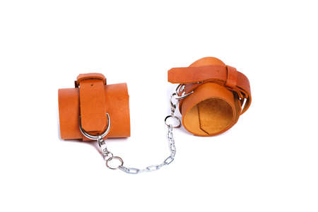 Light brown leather handcuffs. Isolated handcuffs on a white background