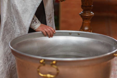 Orthodox priest blesses the water Stock Photo