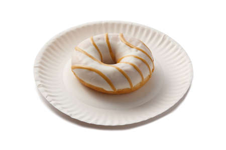 Sweet doghnut in glaze decorated with sprinkles