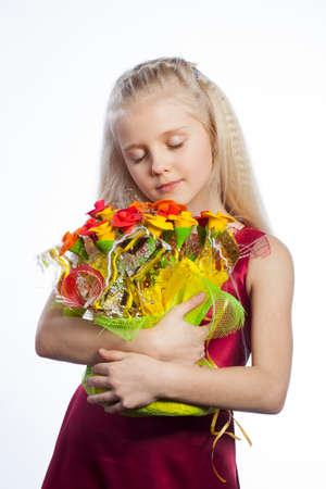 Beautiful girl with bouquet of eatable flowers