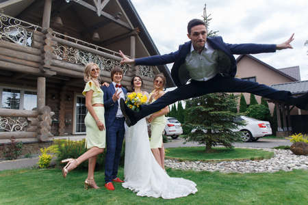 Newly married with bridesmaids and boyfriend having fun on wedding ceremony at the villa