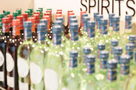 Blurred image of showcase of alcoholic beverages in store.