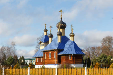 Wooden Orthodox church with golden domes and crosses. Stock Photo