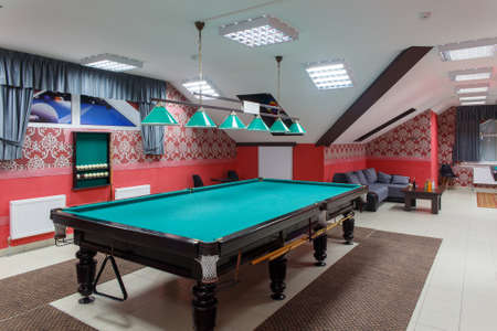 Interior of the billiard club. There are tables for American and Russian Billiards. There are tables for relaxation.