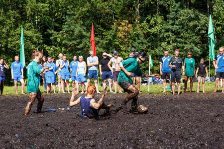 GRODNO, BELARUS - AUG 20: Women battle for the ball in the Open Belarusian championship on marsh football in Grodno, Belarus, August 20, 2016