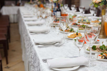 Table set for wedding or another catered event dinner. Concept: Serving. Celebration. Anniversary. Wedding