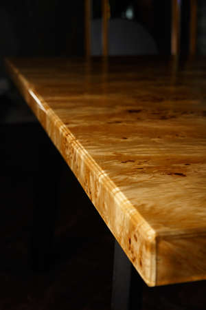 Table top for a table made of poplar burl wood and transparent epoxy resin. The resin is varnished and polished, the wood is saturated with tung oil.