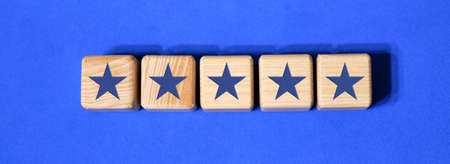 Best Excellent Services Rating customer experience concept. Wooden blocks with the five star. The best rating, the best ranking, the best service on a blue background