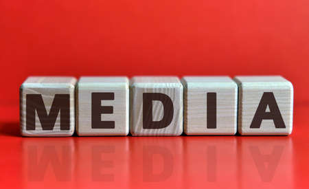 Concept Media on wooden cubes and red background