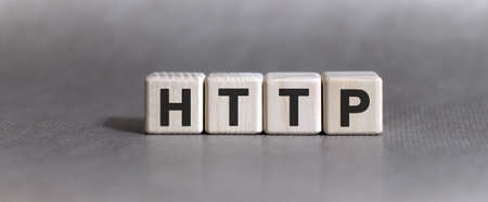 HTTP text on wooden cubes on a monochrome background 免版税图像