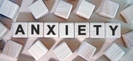 ANXIETY- text wooden cubes and many cubes around