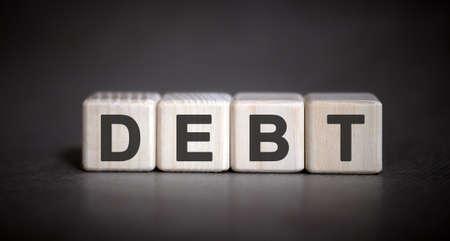 DEBT - financial business concept on a dark background