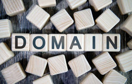 Domain name - text concept website on a wooden background surrounded by cubes