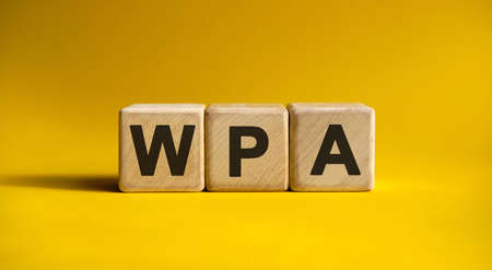 WPA - text on wooden cubes with gradient yellow background