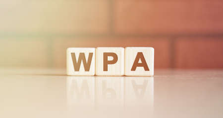 WPA acronym concept. Text on wooden cubes with bright light