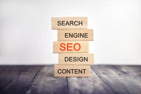 SEO, Search engine, design content - concept text on wooden cubes Archivio Fotografico