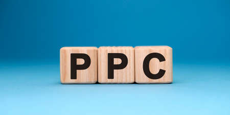 PPC website - text concept on wooden cubes with gradient blue background