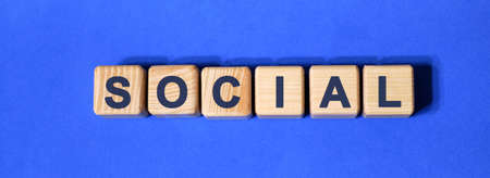 SOCIAL text on wooden cubes on a blue background 版權商用圖片