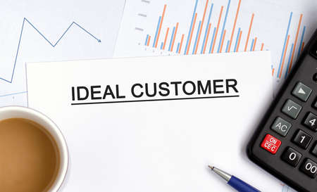 Ideal customer document with graphs, diagrams and calculator and a cup of fragrant coffee