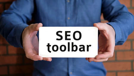 Seo toolbar - seo concept in the hands of a young man in a blue shirt