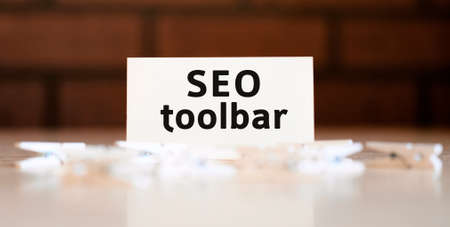 Seo toolbar text of business concept on white list and with clothespins