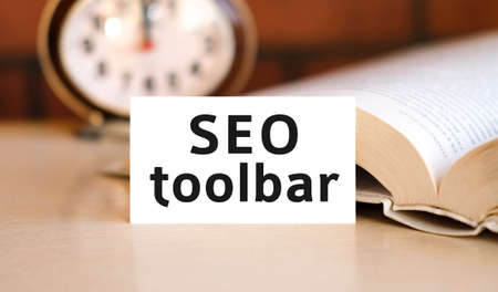 Seo toolbar business concept text on a white book and clock Reklamní fotografie