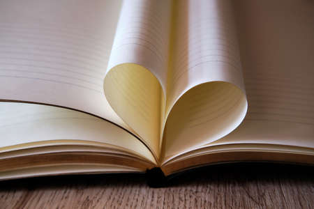 Love heart from the sheets of the book Stock fotó